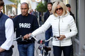 Brigitte Macron protégée par un charmant garde du corps....