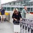 Kate Moss et Jamie Hince arrivent au Terminal 5 de l'aéroport de Londres le 16 juin 2009