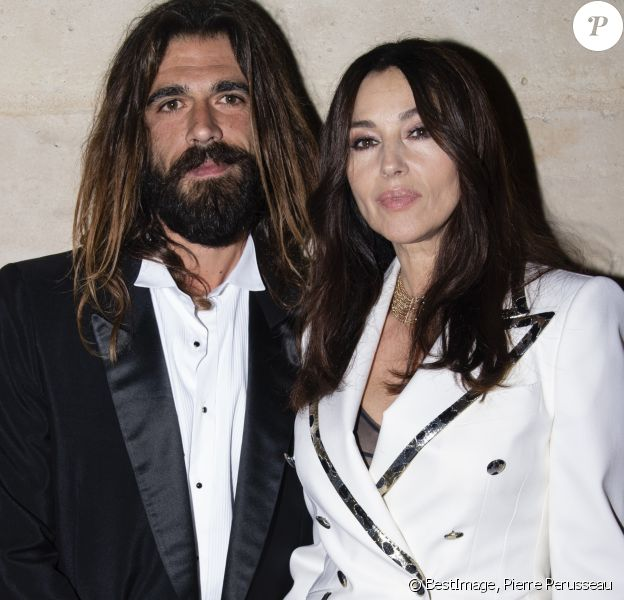 "Monica Bellucci et son compagnon Nicolas Lefebvre au photocall de la soirée de lancement du ""Clash De Cartier"" à la Conciergerie à Paris, France, le 10 avril 2019. © Pierre Perusseau/Bestimage"