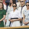 "Catherine (Kate) Middleton, duchesse de Cambridge, Meghan Markle, duchesse de Sussex, et Pippa Middleton dans les tribunes lors de la finale femme de Wimbledon ""Serena Williams - Simona Halep (2/6 - 2/6) à Londres, le 13 juillet 2019. © Ray Tang/London News Pictures via Zuma Press/Bestimage"