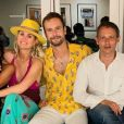 Laeticia Hallyday pose avec Sandra Sisley, Marc-Olivier Fogiel, son mari François Roelants et Liliane Jossua à Saint-Barthélemy le 19 juillet 2019.