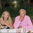 Sylvie Elias et Gérard de Villiers à la soirée Bacardi, à Saint-Tropez. 26/07/09