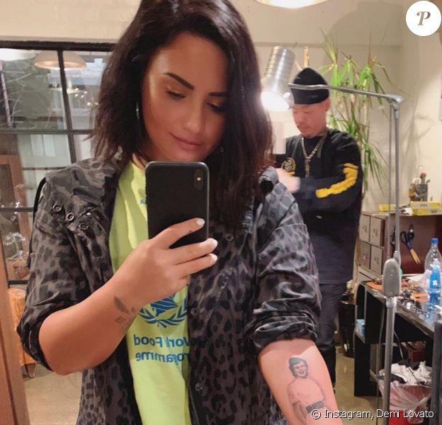 Demi Lovato et l'artiste tatoueur Dr Woo. Avril 2019.