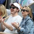Norman Thavaud et sa compagne Martha - Célébrités dans les tribunes des internationaux de France de tennis de Roland Garros à Paris, France, le 9 juin 2019. © Jacovides-Moreau/Bestimage