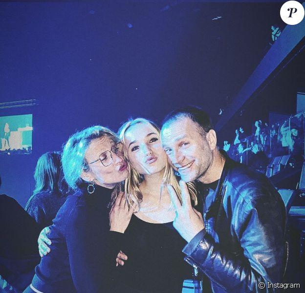 Alexandra Lamy, son ex Thomas Jouannet et leur fille Chloé au concert d'Angèle à Bercy, le 18 février 2020.