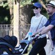 Exclusif - Laura Prepon et son mari Ben Foster promènent leur fille Ella en poussette à New York, le 11 juillet 2018.