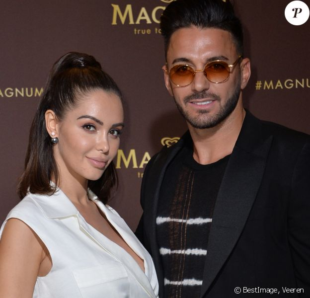 "Nabilla Benattia (enceinte) et son mari Thomas Vergara au photocall de l'after party ""Magnum x Rita Ora"" sur la plage privée Magnum lors du 72ème Festival International du Film de Cannes, France,le 16 mai 2019. © Veeren/Bestimage"