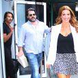 Poppy Montgomery et son mari Shawn Sanford arrivent dans les studios AOL à New York, le 26 juillet 2019.