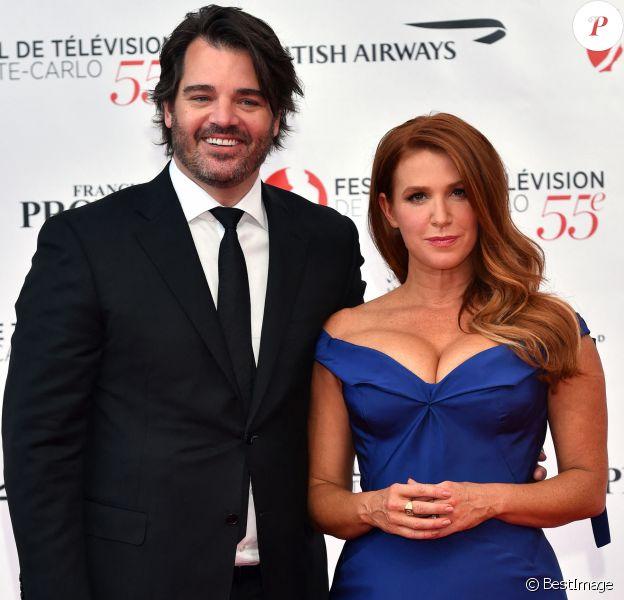 """Poppy Montgomery (de la série """"Unforgettable"""") et son mari Shawn Sanford - Photocall de la soirée d'ouverture du 55ème festival de télévision de Monte-Carlo à Monaco. Le 13 juin 2015"""