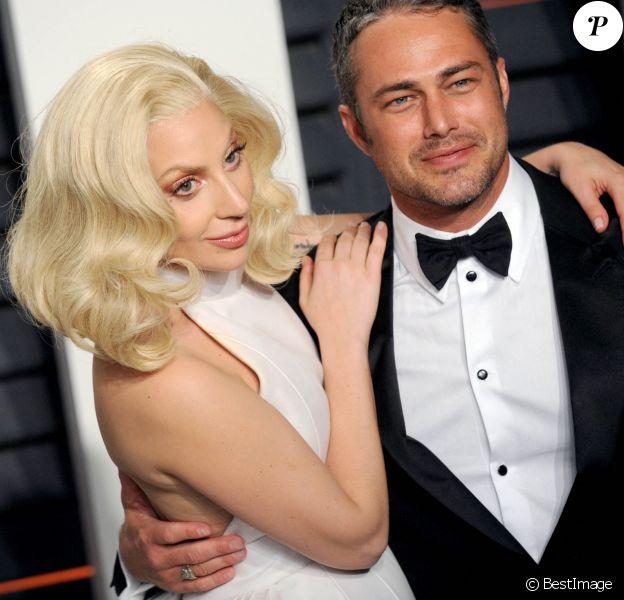 """La chanteuse Lady Gaga et son compagnon Taylor Kinney - People à la soirée """"Vanity Fair Oscar Party"""" après la 88e cérémonie des Oscars à Hollywood."""