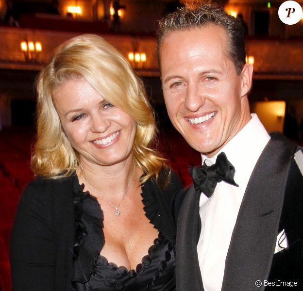 Michael Schumacher et sa femme Corinna lors de la soiree GQ a Berlin en Allemagne