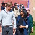 """Le prince Harry, duc de Sussex, et Meghan Markle, duchesse de Sussex, enceinte lors de l'investiture (médaille de l'Ordre de l'Empire britannique) de Michael McHugo, fondateur de """"Education pour tous"""" dans le cadre de leur voyage officiel au Maroc, le 24 février 2019."""