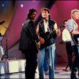 """Archives - Jean-Jacques Goldman, Michael Jones et Johnny Hallyday lors de l'émission """"Champs Elysées""""."""