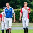 Le prince William, duc de Cambridge et son frère le prince Harry, duc de Sussex lors d'un match de polo de bienfaisance King Power Royal Charity Polo Day à Wokinghan, comté de Berkshire, Royaume Uni, le 10 juillet 2019.
