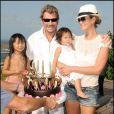 Johnny Hallyday, sa femme Laeticia et leurs filles Jade et Joy. Eté 2009
