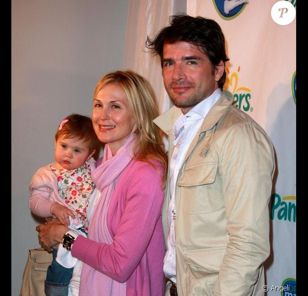 Kelly Rutherford et sa fille Helena, et Matthew Settle, lors de la soirée Pampers à New York, le 18 mars 2010