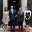 Carla Bruni, David Cameron, Nicolas Sarkozy et Sarah Cameron lors de la commémoration de l'Appel du 18 juin 1940 à Londres, le 18 juin 2010