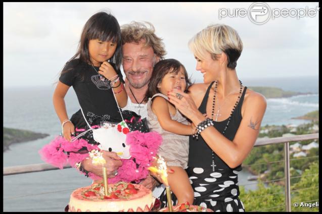 Johnny et Laeticia Hallyday à l'anniversaire de leurs fillettes. 3 août 2010
