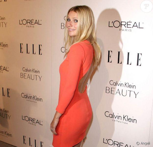 Gwyneth Paltrow annonce la couleur et opte pour le orange avec sa superbe petite robe Calvin Klein.