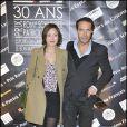 Nicolas Bedos et sa compagne Pom à la remise des prix Patrick-Dewaere et Romy Schneider, au Bon Marché, le 4 avril 2011, à Paris.