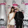 """""""Lou Doillon et Karl Lagerfed lors de la soirée Coca Cola Light pour célébrer le lancement de la bouteille imaginée par Karl Lagerfeld. Le 7 avril 2011"""""""