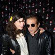 Philippe Manoeuvre et une amie lors de la soirée Vitamin Water aux Chandelles pour le lancement de son nouveau parfum XXX-3 baies le mardi 19 avril 2011