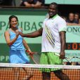 Amélie Mauresmo et Teddy Riner, une équipe pour le meilleur... et pour le rire ! Samedi 21 mai 2011, chaude ambiance à la Porte d'Auteuil, pour l'ouverture des Internationaux de France de Roland-Garros !