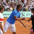 Rafael Nadal et Aravane Rezaï, jolie rencontre ! Samedi 21 mai 2011, chaude ambiance à la Porte d'Auteuil, pour l'ouverture des Internationaux de France de Roland-Garros !