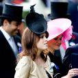 Ascot 2011, jour 4, vendredi 17 juin 2011 : la princesse Eugenie d'York prend la relève de sa soeur Beatrice, venue la veille. La pluie persistante oblige les bibis à se planquer sous les parapluies, mais le rendez-vous tient ses promesses.