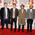 Le groupe anglais Mumford & Sons pose lors des British Awards à Londres en février 2011