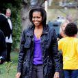 La first lady la plus stylée de l'Histoire Michelle Obama alterne avec succès les tenues de gala et détente. Et comme des millions de personnes dans le monde, elle possède des Converse's Chuck Taylor. A Washington, le 16 mars 2011.