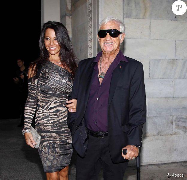 Barbara Gandolfi et Jean-Paul Belmondo lors du défilé de Roberto Cavalli à Milan dans le cadre de la fashion week printemps-été 2012, le 26 septembre 2011