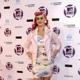 Surfant sur la vague eighties de son dernier single Last Friday Night, Katy Perry soutenait son ami styliste Jeremy Scott avec un look teinté de rose. Belfast, le 6 novembre 2011.