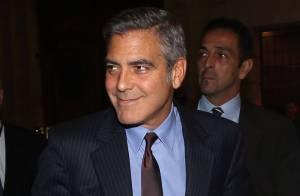 George Clooney avec une businesswoman sexy... What else ?