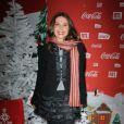 Victoria Abril lors d'une soirée au profit de l'association Petits Princes et de lancement du train rouge Coca Cola, le 15 décembre 2011, à Paris