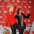 Victoria Abril et Anna Sherbinina, déchaînés, lors d'une soirée au profit de l'association Petits  Princes et de lancement du train rouge Coca Cola, le 15 décembre 2011, à  Paris