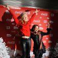 Victoria Abril et Anna Sherbinina lors d'une soirée au profit de l'association Petits  Princes et de lancement du train rouge Coca Cola, le 15 décembre 2011, à  Paris