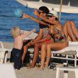 Lilly Kerssenberg, son petit Amadeus et Noah Becker sur la plage de Miami le 26 décembre 2011