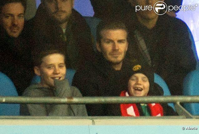 David Beckham et ses enfants Brooklyn, Romeo et Cruz, le 8 janvier 2012 à Manchester, lors de la victoire de United sur City (3-2).