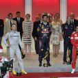 Le moment des hymnes nationaux, la famille princière et les pilotes recueillis... La princesse Charlene a suivi le Grand Prix de Monaco, le 27 mai 2012, entre le prince Albert, la comtesse Sophie de Wessex et les frères Andrea et Pierre Casiraghi, avant de prendre part à la cérémonie de remise des trophées, à l'issue de la victoire de Mark Webber.