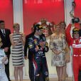 La princesse Charlene a suivi le Grand Prix de Monaco, le 27 mai 2012, entre le prince Albert, la comtesse Sophie de Wessex et les frères Andrea et Pierre Casiraghi, avant de prendre part à la cérémonie de remise des trophées, à l'issue de la victoire de Mark Webber.