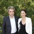 Dominique Rocheteau et son épouse Laurence posent à Paris, dans les coulisses du tournoi de Roland-Garros, le mardi 29 mai 2012.