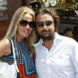 Henri Leconte et son épouse Florentine posent à Paris, dans les coulisses du tournoi de Roland-Garros, le mardi 29 mai 2012.