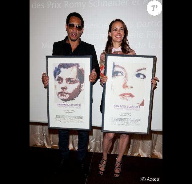 Bérénice Bejo et JoeyStarr, fiers et souriants, lors de la cérémonie de remise des Prix Romy-Schneider & Patrick-Dewaere, à Paris, le 11 juin 2012