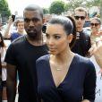 Kim Kardashian et Kanye West se rendent à l'ouverture d'une boutique de la marque Dash des soeurs Kardashian, à Melrose Place le 13 juillet 2012