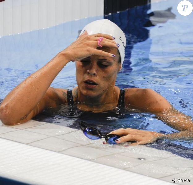 Laure Manaudou déçue après son élimination en série du 100 mètres dos le 29 juillet 2012 à l'Aquatics Center de Londres lors des Jeux olympiques 2012