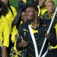 Usain Bolt, porte-drapeau de la délégation jamaïcaine lors de la cérémonie d'ouverture des Jeux olympiques de Londres 2012. 27 juillet