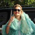 Rita Ora avait peut-être un peu chaud avec sa veste en fourrure lors de son arrivée aux studios de Radio 1 à Londres, le 10 août 2012.
