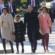 Sasha et Malia Obama entourées de leurs parents en décembre 2011