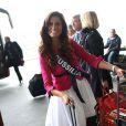 Celia Guermoudj, Miss Midi-Pyrenees, arrive à l'aéroport Charles de Gaulle avant de s'envoler pour l'Île Maurice, à Paris le 14 novembre 2012